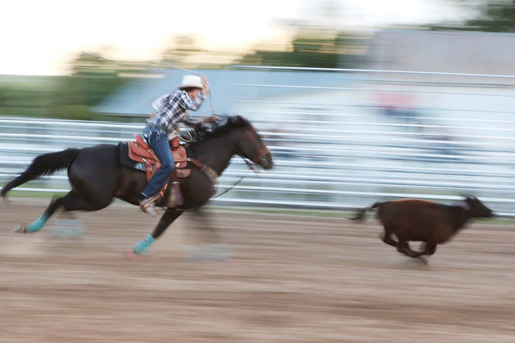 Cowgirl Abbea Fans streaks after a calf in the Breakaway competition. Abbea was one of 11 breakaway ropers competing in Friday evening's Cowboy Up in Kiowa Rodeo.