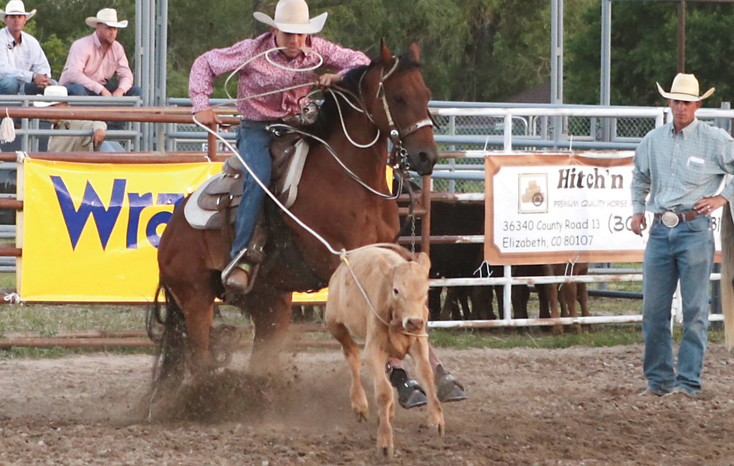 Cowboy Garrett Arnold ropes calf during the tie-down roping competition at the Cowboy Up in Kiowa performance on Friday night. The Cowboy Up rodeo was voted most improved rodeo in Colorado in 2015 by the Colorado Professional Rodeo Association.