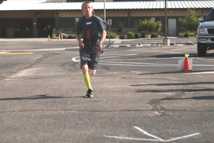 Tayden Wangrow sprints to the finish at the first annual Fear the Spear 5K run and walk. Wangrow completed the a course winding five Kilometers through Kiowa in 23 minutes 46 seconds.