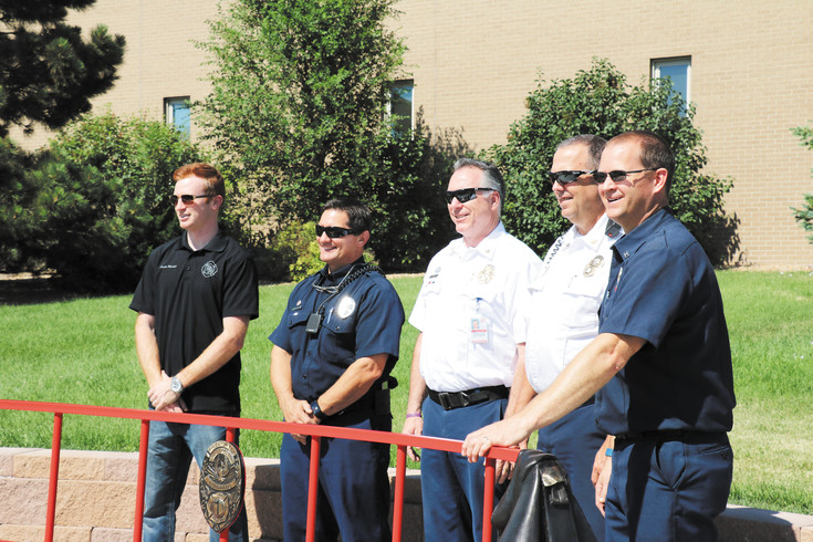 West Metro Fire team members celebrate the unveiling of a new art bench outside of fire station No. 1 on 14th Avenue.