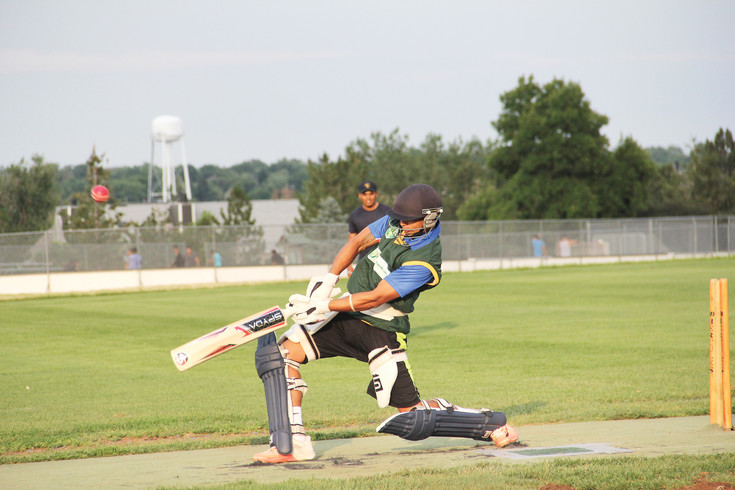 Jay Pathak plays a shot during batting practice with the Littleton Cricket Club. Pathak is an all-rounder, meaning he both bats and bowls for the team.