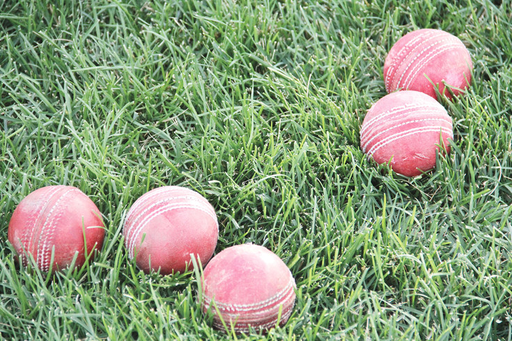 Cricket balls are wrapped in leather and stitched.