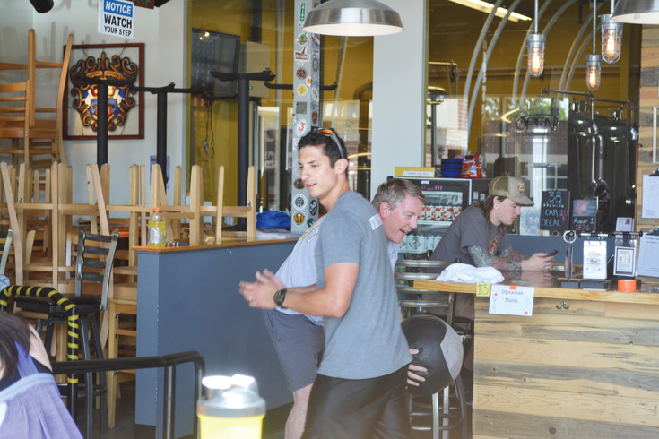 Personal trainer Paul Chavez motivates his pupils at a Brewery Boot Camp workout at 38 State Brewing Company on Memorial Day weekend.