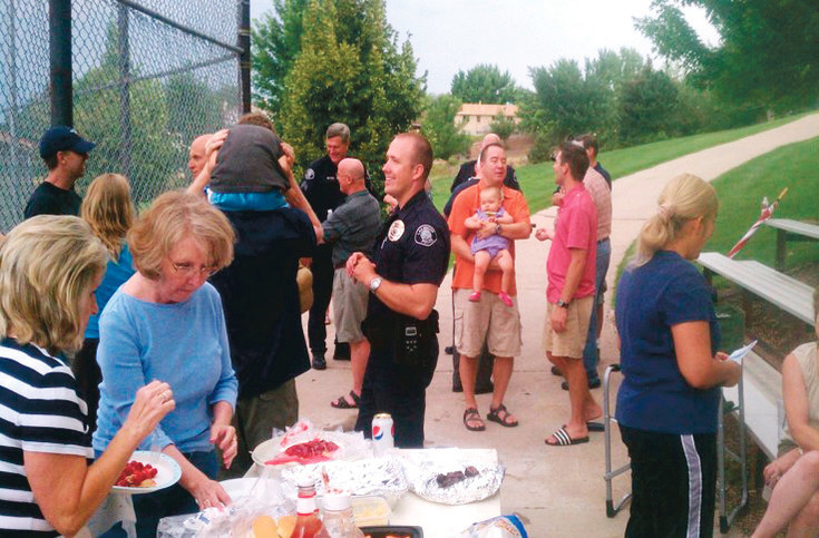 Lakewood Police visit a block party during National Night Out. The annual event uses block parties as a way to foster better communication between police and residents. Photo courtesy of Lakewood Police Department