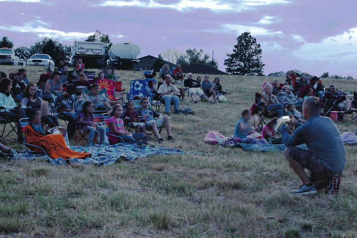 "Families gather on the hillside to for Elizabeth's second annual Outdoor ""Walk-In"" Movie Night. This year's feature presentation was ""The Goonies."""