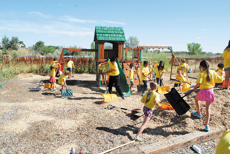 Youth participants of the inaugural Camp Kind — a project of Chabad of NW Metro Denver and its executive director, Rabbi Benjy Brackman — spread mulch at the playground of a Westminster Hebrew school early July 21, about an hour before the group headed to Boondocks in Northglenn for a day of R and R. The purpose of the camp, as the name might imply, is to teach youth the value of kindness, hard work and volunteerism. Courtesy photo