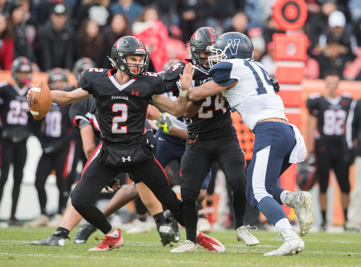 Pomona QB Ryan Marquez (2) scrambles as teammate Kenny Maes (24) tries to keep Valor Christian defender Christian Elliss (14) away. Photo by Paul DiSalvo