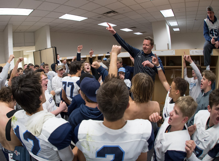 Valor Christian Head Coach Rod Sherman celebrates with his team following their 30-14 win over Pomona in the 5A State Final on Saturday at SportsAuthority Field in Denver. Photo by Paul DiSalvo