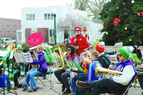 The Holiday Low Brass perform in Olde Town Square in Arvada during the first Saturday with Santa on Dec. 3.