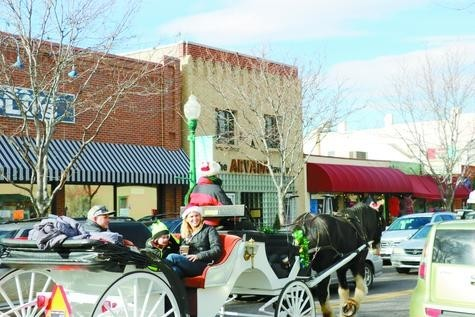 Arvada residents get an old carriage ride around Olde Town during the first of three Saturdays with Santa on Dec. 3.