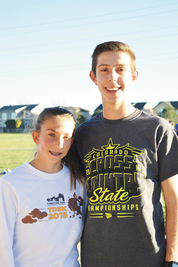 Freshman Jenna Fitzsimmons (left) and senior Josh Romine of Mountain Vista were named the 2016 Colorado Community Media Boys and Girls Cross Country Runners of the Year.