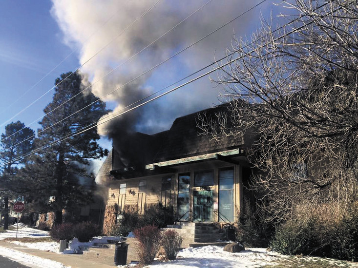 A mid-morning fire engulfs the Scenic Heights Office Building, 6475 Wadsworth Blvd., on Jan. 2, claiming one life. The building was a complete loss and has since been demolished.
