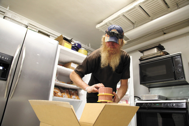 Kenny Levan, a homeless man in Olde Town Arvada, helps unpack food for The Rising Church's food back. He has volunteered with the pantry for four years.