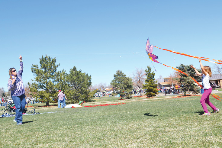 """We love it ... It's just fun.""  While waiting for the breeze to pick up, Brenda and Amber Musick, Northglenn residents, said they've been enjoying the kite festival for the past few years."