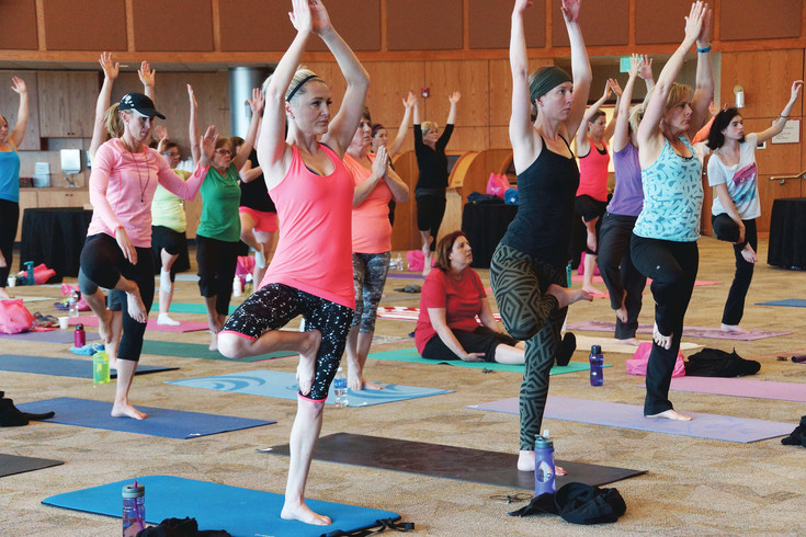 "Yogis hold tree pose in a Holy Yoga class led by Amber Jaworsky, of Highlands Ranch. ""The exercises of yoga are designed to put pressure on the glandular systems of the body, thereby increasing efficiency and total body health,"" said Jaworsky."