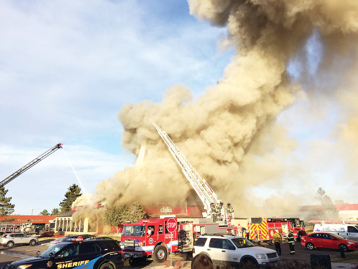Crews from the South Metro and Littleton fire departments battle a blaze Dec. 27 at the Chili's restaurant at County Line Road and University Boulevard in Highlands Ranch.