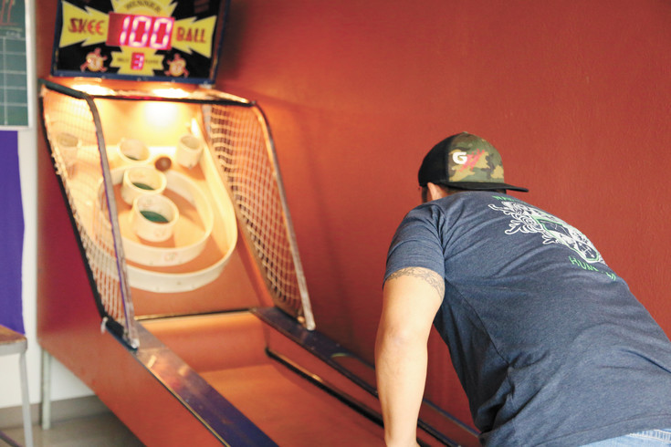 Luke Caudillo is on on of the four teams in the Skee Ball mini league at Someplace Else Brewery.