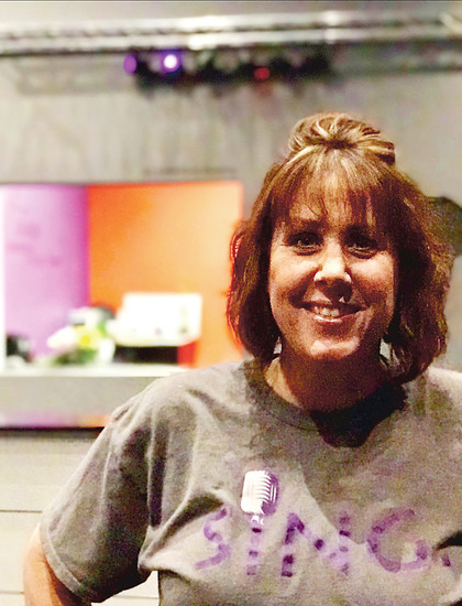 Jeni Winslow, owner of Headliners Vocals. She and her husband opened their business last September in hopes of providing a space for kids to feel like rock stars.