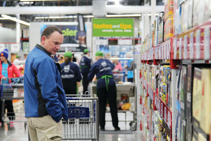Tony Lensing of Castle Rock looks over the alcohol selection at Castle Rock's new Sam's Club.