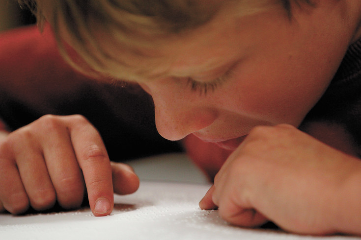 Asher Koren-Zoloto, 9, reads Braille during a tmed reading comprehension test as part of the 2017 Braille Challenge at the Colorado Center for the Blind in Littleton on Jan. 26. The nationwide competition has been taking place for 13 years.