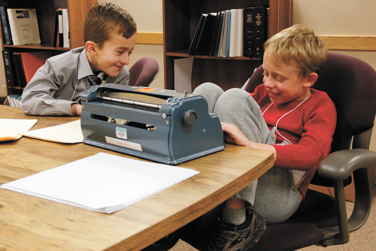 Matthew Falco, 8, on the left, and Asher Koren-Zoloto, 9, enjoy a private joke during a break in the competition at the 2017 Braille Challenge. A goal of the competition, held at the Colorado Center for the Blind in Littleton, is fostering a sense of community among the participants, many of whom are the only vision-impaired students at their schools.