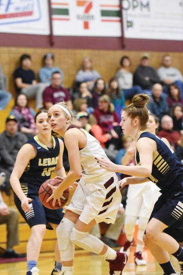 Horizon senior guard Kylie Jimenez drives through Legacy defenders Kaylea Beck and Katelyn Pedersen during the third quarter of the Jan. 27 game in Thornton. Jimenez led all scorers with 36 points as Horizon easily defeated Legacy, 66-47.