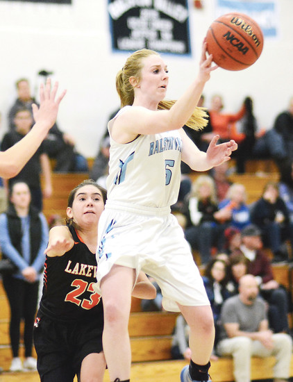 Ralston Valley senior Ashley Van Sickle (5) is able to get off a pass in front of Lakewood freshman Nadia Trevizo (23) during the second half Jan. 27 at Ralston Valley High School.