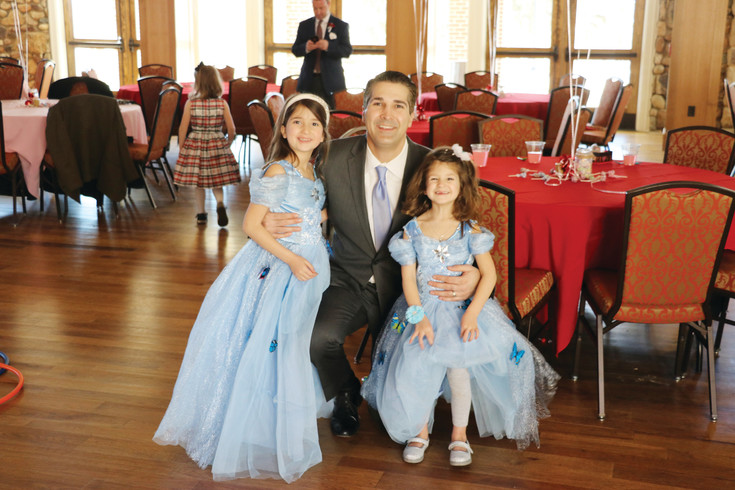 Ella Szymanski, left, Sean Szymanski and Sophia Szymanski attend the Father-Daughter Sweetheart Ball. The father and his two daughters, who are 6 and 3 years old, look forward to it every year.