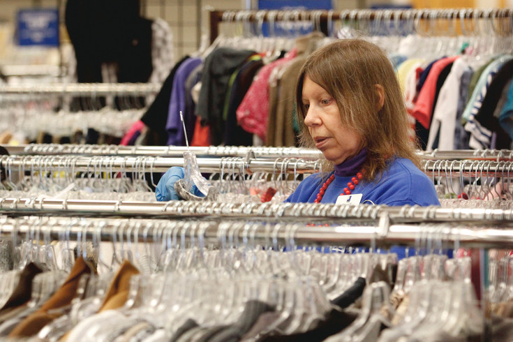 "Simone Mielnicki of Parker stocks the racks of the Goodwill Thrift Store there. Mielnicki says she has ""super bosses"" and enjoys working with the customers, and their children, at the store."