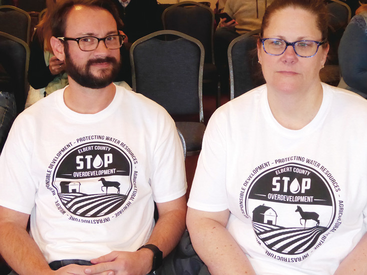 Todd and Victoria Thalimer of the group SOD Elbert-Stop Over Development have created T-shirts to display their opposition.