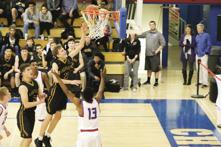 Kyle Lukasiewicz puts the ball off the glass for Arapahoe during the Feb. 8 league basketball game against Cherry Creek. Lukasiewicz led the Warriors in scoring with 16 points as Arapahoe traveled to Cherry Creek for the rivalry game. The Bruins held the lead for much of the game but the Warriors put on a fourth-quarter rally to win the game 67-63.