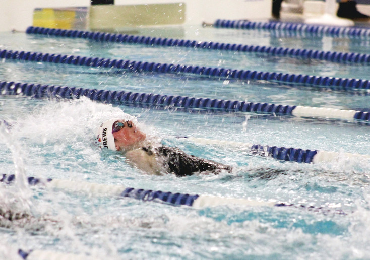 Kylie Andrews of Heritage won the 100 backstroke at the Class 4A State Championships at the Eldora Pool Ice Center in Fort Collins. In a close finish, she edged Fort Collins' Audrey Reimer  with a time of 55.67.