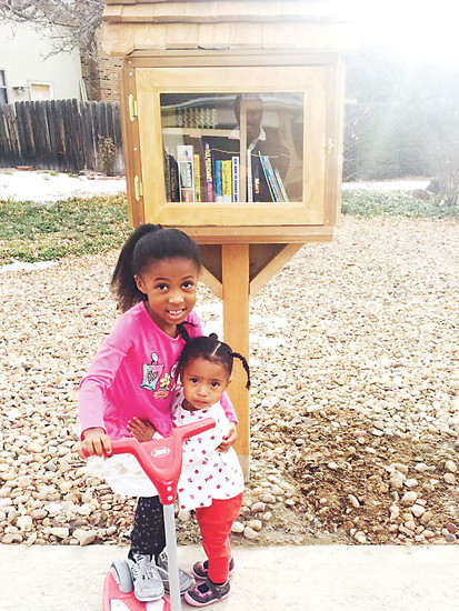 London and Lauren Branch helped their father, Fernando, build a Little Free Library for the Centennial neighborhood they live in. London runs to the book house after the school bus drops her off to see if any new books were added that day.