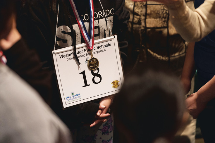 A young girl wearing her spelling bee contestant number. Celebrating Academic Excellence is an annual event that attracts students from STEM and traditional schools in the Westminster Public Schools district.