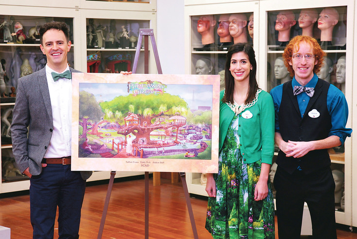 "Former Northglenn resident Nathan Evans, left, stands with the rest of his team from Savannah College of Art and Design, Emily Peck and Andrew Reiff. Between them is a rendering of their project, ""Hideaway Grove,"" chosen as one of six finalists in the 2017 Walt Disney Imagineering Imagination Design Competition."