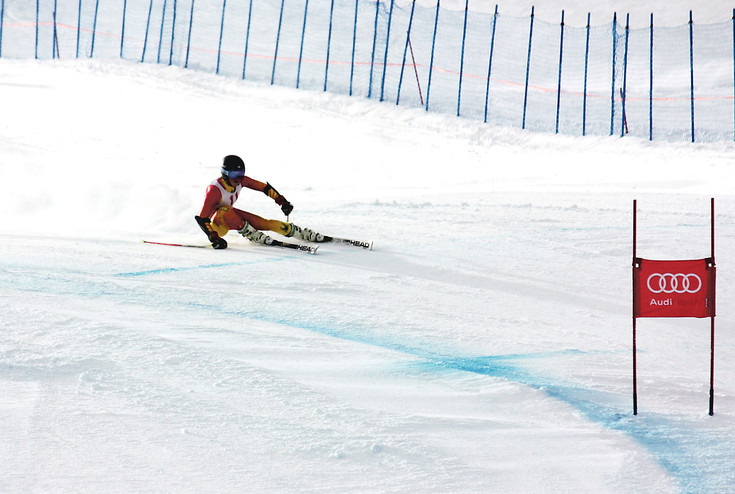 Casey Adams carves a turn in a time trial at the International Ski Federation Speed Series in Vail in January. Adams, 17, recently qualified to compete with members of the United States Ski Team in February.