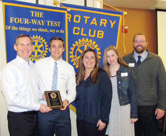 Daniel Ness receives his award after being selected by the Rotary Club of Parker as Student of the Month for January. Pictured from left are Rotarian Steve Budnack, Ness, his mother Sara, his sister Rachel and his father, David.
