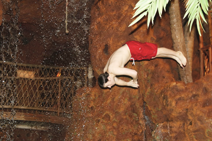 Max Spiegel in mid-dive during a performance at Casa Bonita. Spiegel was a diver at Cherry Creek High School.