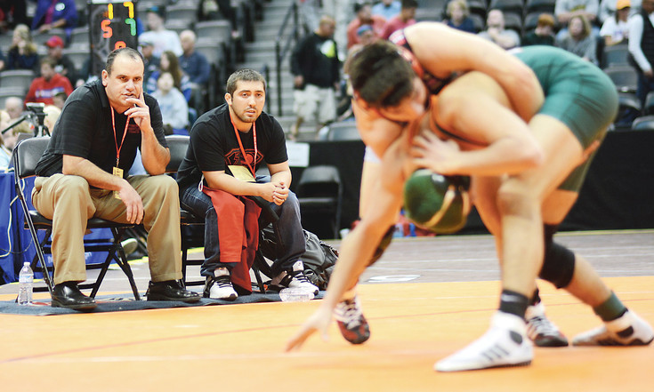 Pomona coach Sam Federico, far left, has the Panthers' wrestling program on an impressive run. Pomona has finished first or second in the Class 5A state team standings for seven straight years.