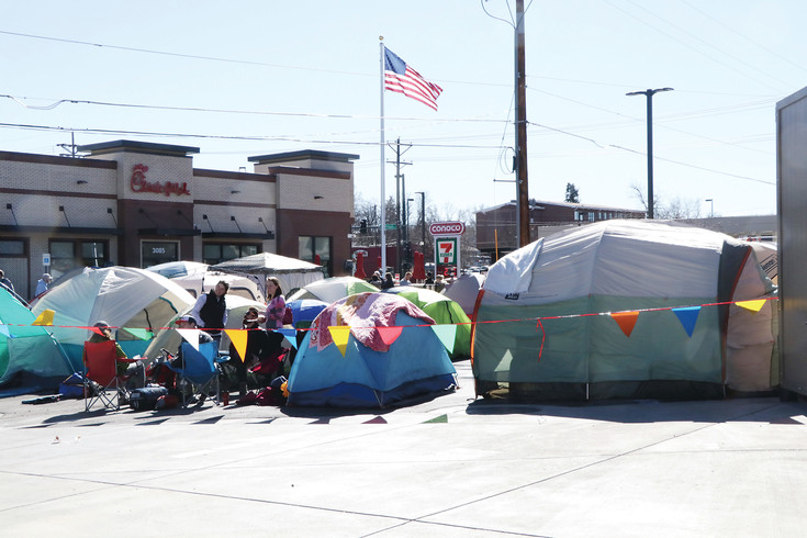 A tent city was set up Feb. 22 by individuals, couples and families eager to be among the first 100 customers at the Feb. 23 opening of the Englewood Chick-fil-A restaurant because the first 100 customers receive a card for 52 free meals. Candidates began lining up at 6 a.m. and there were more than 100 in line by 9 a.m.