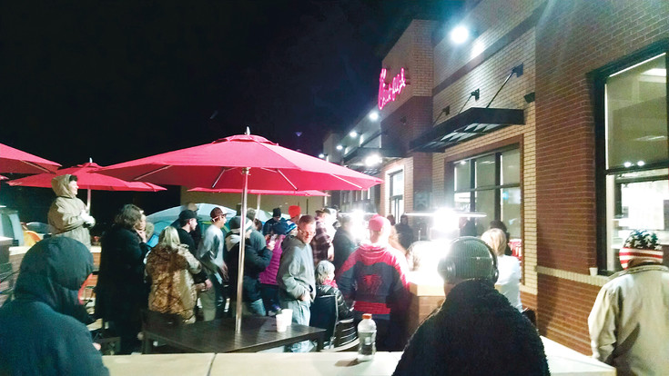 Tents and chilly Chick-fil-A aficionados crowd the parking lot on the night of Feb. 22 at the new Chick-fil-A restaurant at Broadway and Dartmouth Avenue in Englewood. Hopeful patrons were lining up to be among the first 100 customers to enter at the 6 a.m. grand opening on Feb. 23, which brings a reward of free meals for a year.