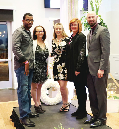 Willie, left, and Mindy Walker, the couple that won a wedding package; Chrystal Huskey, campaign manager; Jeremy Friedman, general manager of the Falls Event Center; and Sandra Coen, president and founder of James Resource Network.