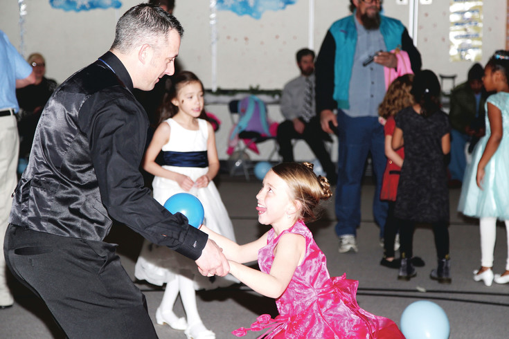 Chris Woodruff dances with his daughter, London, a thrid-grader at Little Elementary.