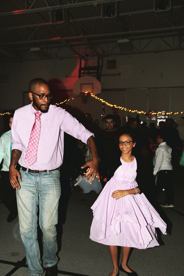 Ron Lipsey gives his daughter, Bella, a spin on the dance floor at the annual Little Elementary father-daughter dance.