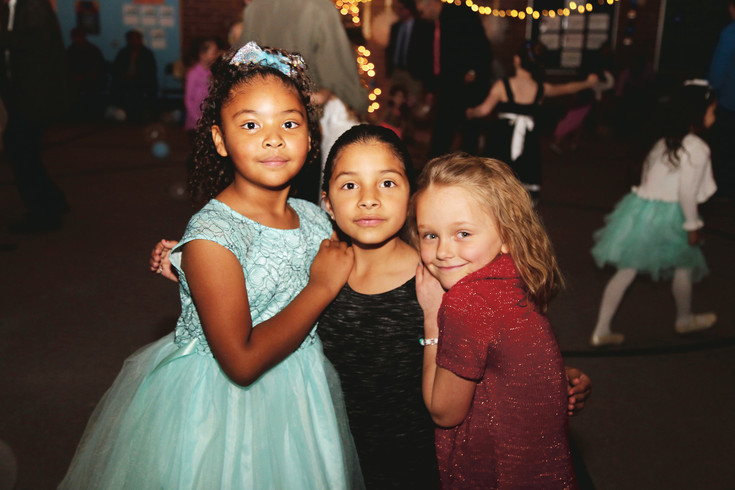 From left, Raven Woods, Allison Vazquez and Reagan Hemans take a break from dancing to pose for the camera Feb. 24 at the Little Elementary father-daughter dance.