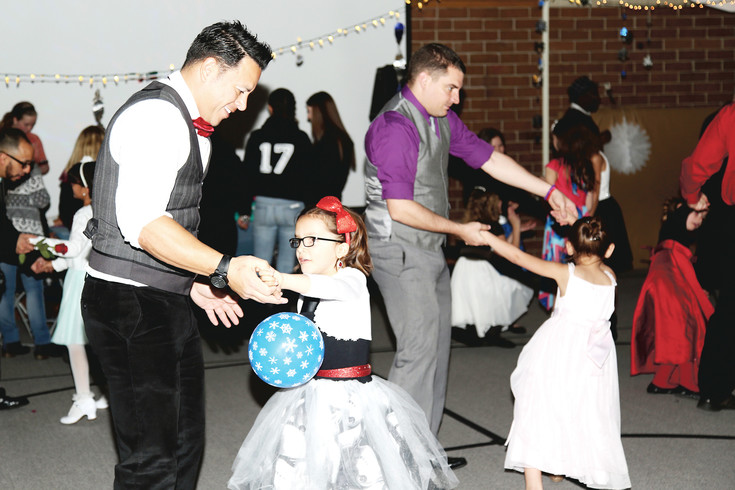 Natalio Martinez and his daughter Valentina were among many to dance the night away at the dance sponsored by the PTSA.