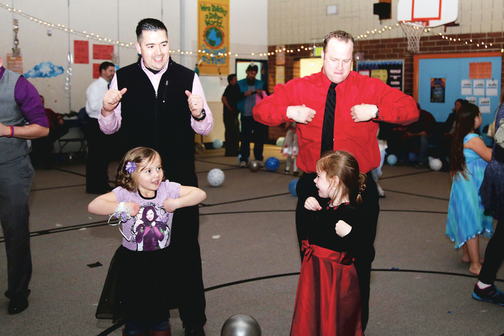 The chicken dance was one of the favorites at the Little Elementary father-daughter dance Friday, Feb 24.