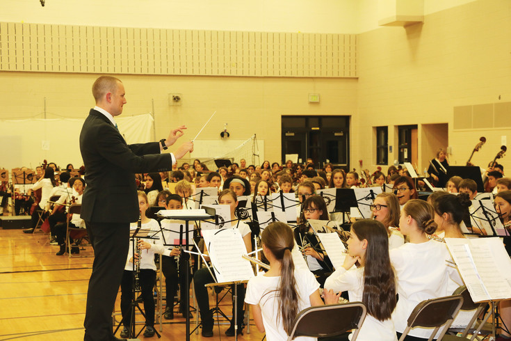 Brian Margrave, 4th through 8th grade band teacher in the Cheyenne Mountain School District, conducted the band group at the annual Elementary Instrumental Music Festival at Creighton Middle on Feb. 23.