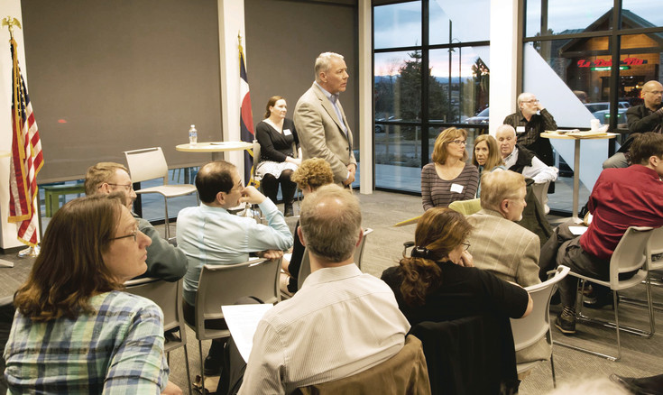 U.S. Rep. Ken Buck listens during a meeting with Indivisible members in Douglas County on Feb. 21.
