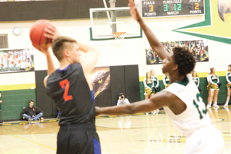 Legend's Blake Fields keeps the ball away from Issac Essien of Mountain Vista during the Feb. 25 Class 5A second-round playoff game held at Mountain Vista. Legend led for most of the game until Mountain Vista pulled away in the fourth quarter to post a 47-39 victory.